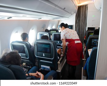 Singapore, Singapore - August 16, 2018 : Inside the premium economy class in flight of Cathay Pacific Airbus 350-900