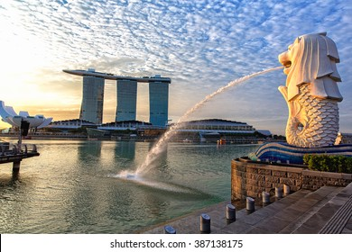 SINGAPORE - AUGUST 2: The Merlion fountain in front of the Marina Bay Sands hotel on August 2, 2015 in Singapore. Merlion is a imaginary creature with the head of a lion, seen as a symbol of Singapore