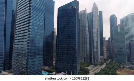 Singapore - August, 2018: Top view of panoramic scene of day of majestic cityscape with modern new buildings. Shot. Modern futuristic buildings architecture. Top view of megapolis skyscrapers with