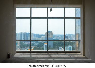 Singapore - August 2019: Unfilled office with window overlooking city