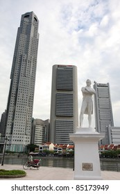 SINGAPORE - AUGUST 21: The statue of Sir Stamford Raffles (the founder of Singapore) at the Raffles Landing Site, next to tall buildings and an old trishaw, on August 21, 2010 in Singapore.