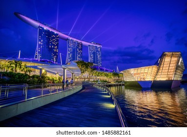Singapore, Singapore - August 22 2019: The city of Singapore's Marina Bay evening laser show