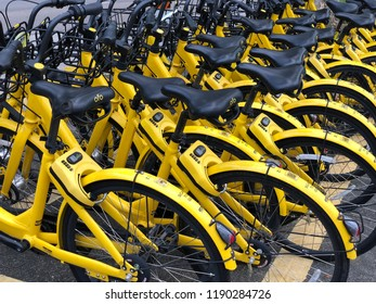 Singapore -August 23, 2018: OFO shared bikes parked on the designated area. Land Transport Authority (LTA) requires a full licence for company to operate dockless bicycle rental services.