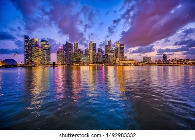 Singapore, Singapore - August 23, 2019: Singapore Central Business District seen from Marina Bay Sands development at night