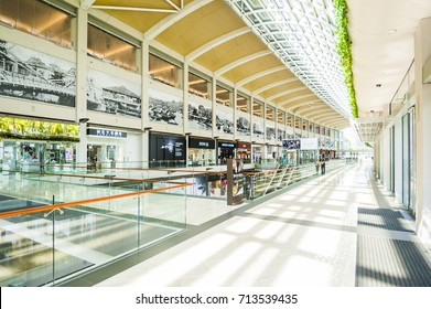 """SINGAPORE - August 23: Timelapse in motion - inside view in the shopping mall """"The Shoppe"""" at Marina Bay Sands on August 23, 2017 in Singapore."""