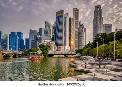 Singapore, Singapore - August 24 2019: The Central Business District of Singapore at sunset seen from the Singapore River