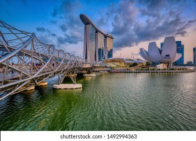 Singapore, Singapore - August 24 2019: The iconic architecture of Marina Bay Sands and the ArtScience Museum in early evening in Singapore's Marine Bay