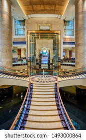 Singapore, Singapore - August 24 2019: The main staircase in the Fullerton Hotel, Singapore, formerly the General Post Office Building