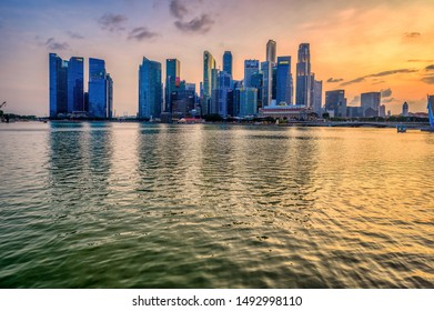 Singapore, Singapore - August 24 2019: Singapore's central business district seen from Marina Bay Sands area at sunset