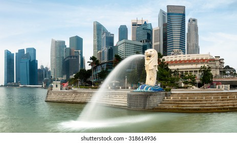 SINGAPORE - AUGUST 25, 2015: The Merlion statue fountain and the Singapore skyline. The landmark statue is considered the personification of Singapore.