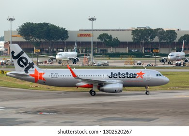 Singapore - August 26, 2014: Jetstar Asia Airbus A320-232 airliner at Changi International Airport in Singapore.