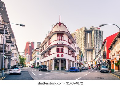 SINGAPORE -  AUGUST 31,2015 : Singapore heritage buildings in Chinatown against the new skyscraper as backdrop taken on  August 31, 2015