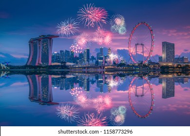 Singapore- August 4, 2018: Singapore national day NDP Preview fireworks in  the evening at marina bay with marina bay sand and singapore flyer cityscape