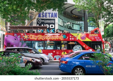 SINGAPORE - AUGUST 6, 2014_City Sightseeing Singapore, Hop On Hop Off bus tour, open-topped double-decker bus for best sightseeing views, tourists can enjoy full loop around the city