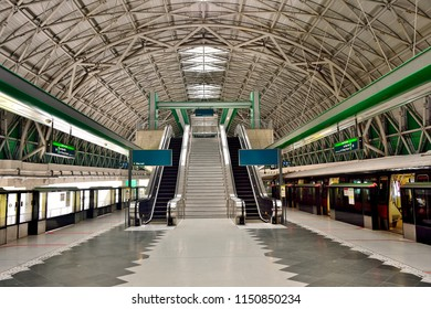 Singapore - August 6th 2018: View of modern station platform and escalators at Tuas Link MRT station on the East, West Singapore train line