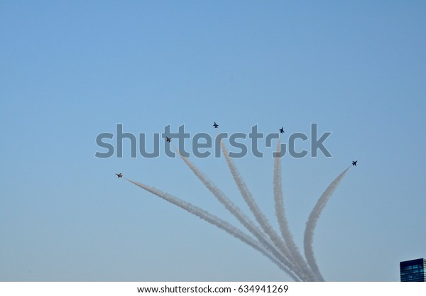 SINGAPORE- AUGUST 9: Squadron of F16s performing stunts during Singapore National Day Parade August 09, 2012 in Singapore