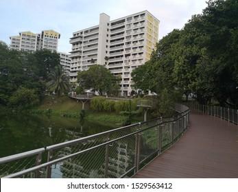 Singapore, Bukit Panjang, 10 13 2019: Pang Sua Pond with HDB buildings landscape
