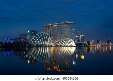 Singapore business district skyline before sunrise at Marina Bay, Singapore.