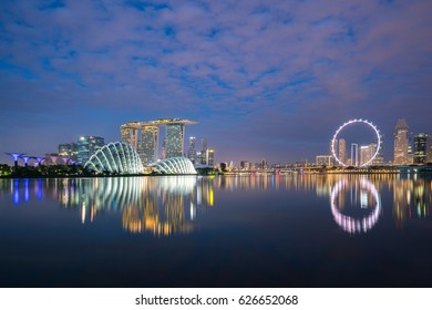 Singapore business district skyline at night in Marina Bay, Singapore