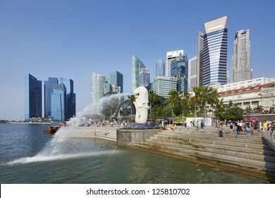 Singapore center with Merlion and skyscrapers
