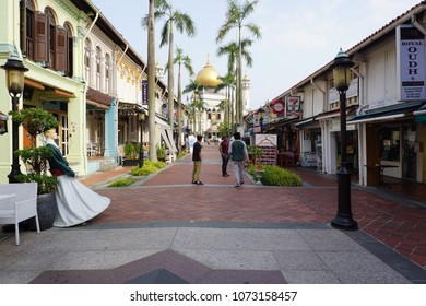 Singapore - CIRCA, 2018: Shops alongside Bussorah Street, with background of the Sultan Mosque. There are many shops ranging from restaurants to convenience stores along the Bussorah Street.