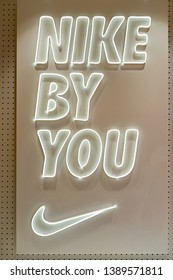 "SINGAPORE - CIRCA APRIL, 2019: close up shot of ""Nike by You"" inscription at Nike store in Jewel Changi Airport."