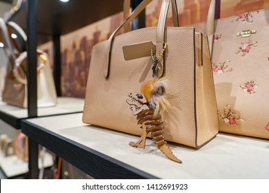 SINGAPORE - CIRCA APRIL, 2019: close up shot of women's bags on display at Coach store in Jewel Changi Airport.
