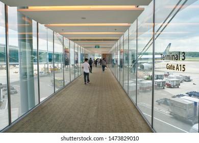 SINGAPORE - CIRCA APRIL, 2019: interior shot a passenger boarding bridge at Singapore Changi Airport.