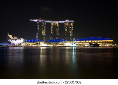 SINGAPORE - CIRCA JANUARY 2015 : Marina Bay Sands hotel and Lotus Architecture highlighted at night in Singapore
