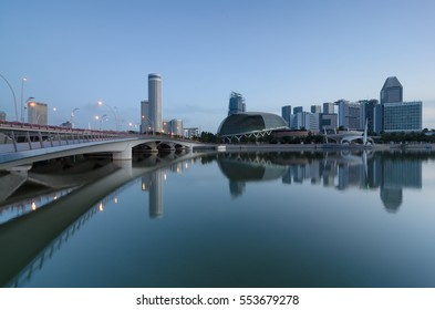 Singapore - circa January 2017 - Reflection view of city in Marina Bay during blue hour.