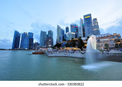 SINGAPORE - CIRCA JULY 2015: Merlion statue fountain in Merlion Park and Singapore city skyline circa July 2015. This fountain is one of most well known icons of Singapore