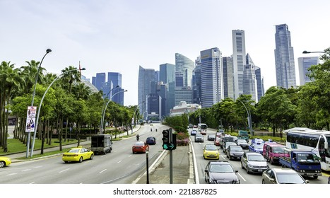 SINGAPORE - CIRCA MAY 2014: The traffic in Singapore. The government spend SGP$14 billion to improve Singapore's road infrastructure over the coming years.