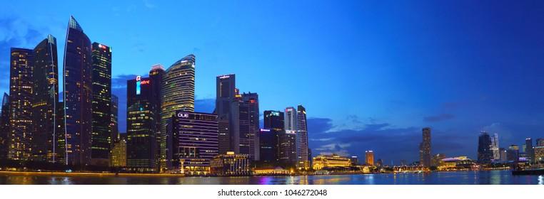 SINGAPORE - CIRCA MAY 2017: Beautiful panoramic landscape of Singapore city skyline at night with reflection