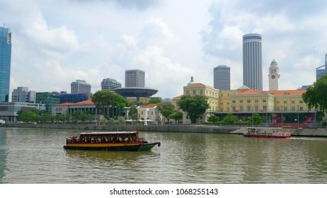 SINGAPORE - CIRCA MAY 2017: Tourist ship sails by Singapore river from the Marina Bay, Singapore.