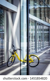 Singapore - Circa month, 2018: A yellow bicycle from ofo (bicycle sharing company) parking in front of singapore mall.
