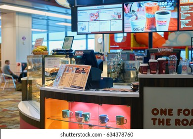 SINGAPORE - CIRCA SEPTEMBER, 2016: Dunkin Donuts at Singapore Changi Airport. Changi Airport is one of the largest transportation hubs in Southeast Asia.