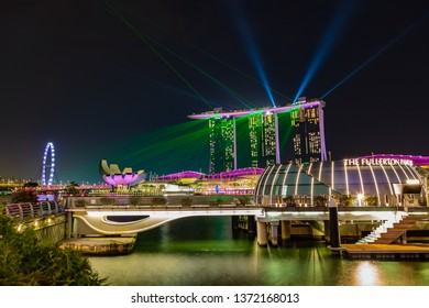 SINGAPORE, SINGAPORE - CIRCA SEPTEMBER, 2017: Marina Bay skyline view of Singapore town by night in front of Marina Bay Sands Hotel.