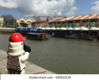 Singapore city, Singapore: 7 June 2016 - Lego Stormtrooper taking a photo of Clark Quay area. This mini figure is from Star Wars sets. Lego is a brick brand by Lego group.