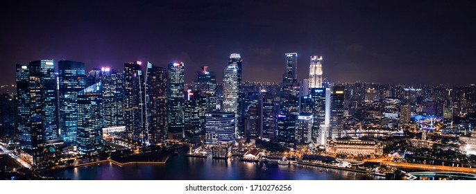SINGAPORE CITY, SINGAPORE - April 03, 2019: Areal panoramic view of Singapore business district and city, helix bridge.