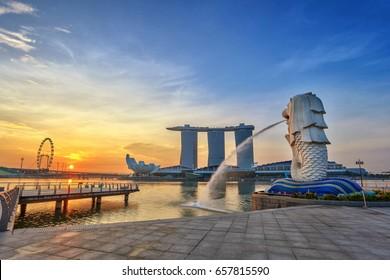 SINGAPORE CITY, SINGAPORE: APRIL 13,2013: Sunrise at Merlion and Singapore city skyline with Singapore Flyer