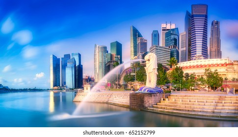 SINGAPORE CITY, SINGAPORE: APRIL 17,2017: Sunrise at Merlion and Singapore city skyline with Singapore Flyer