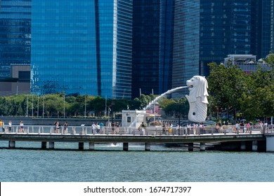Singapore city, Singapore - february 27, 2020 : Merlion statue spraying the water from its mouth at Merlion Park in downtown core of Singapore at Marina Bay at at day time
