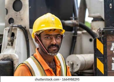 Singapore city, Singapore - february 28, 2020 : A migrant worker poses for a photo on a city centre construction site in Singapore. The SE Asian city state has a significant migrant worker population