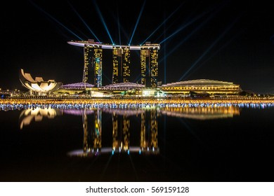 Singapore City, Singapore - July 17, 2012: Marina Bay skyline and Merlion in the night. The Marina Bay is a bay near Central Area in of Singapore, and lies to the east of the Downtown Core.