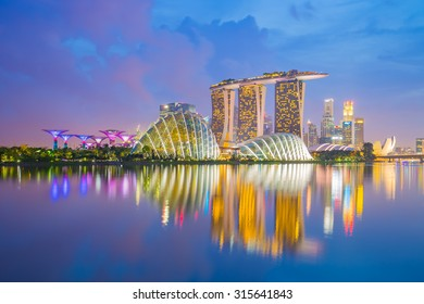 Singapore City, Singapore - July 17, 2015: Marina Bay skyline and Merlion in the morning. The Marina Bay is a bay near Central Area in of Singapore, and lies to the east of the Downtown Core.