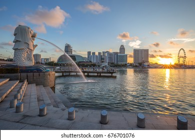 Singapore City, Singapore - June 28, 2017: View of Merlion statue, symbol of Singapore, with famous Marina Bay Sands hotel in the background.