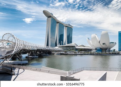 Singapore city landscape at day blue sky. Pedestrian DNA bridge at Marina Bay view. Urban cityscape