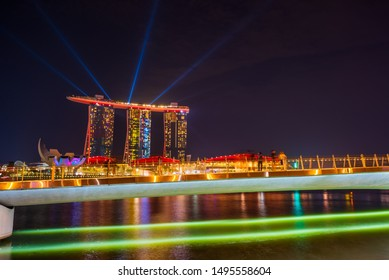 SINGAPORE CITY, SINGAPORE - MARCH 3, 2019: Spectra Light and Water Show Marina Bay Sand Casino Hotel Downtown Singapore