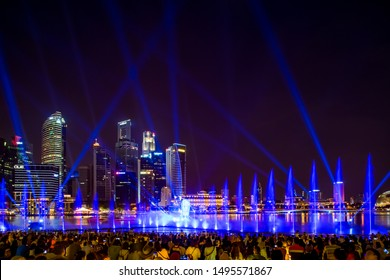SINGAPORE CITY, SINGAPORE - MARCH 7, 2019: Front view of Spectra Light and Water Show Marina Bay Sand Casino Hotel Downtown Singapore