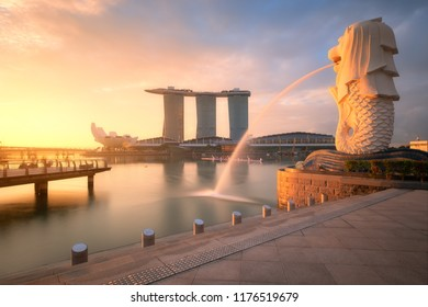 SINGAPORE CITY, SINGAPORE: May  29,2018: Sunrise at Merlion and Singapore city skyline with Singapore Flyer in morning.